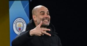 Guardiola wants Liverpool to sort matters after fan spits at Man City bench
